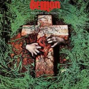 Two hands claw at a tombstone made of flesh on the album cover.