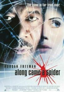 Morgan Freeman and Monica Potter look determind behind a spider's web on the movie poster.
