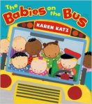 A number of Katz' signature babies crowd into the front of the bus on the cover of the book.