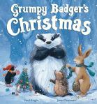Badger, grumpy, stands amonst a bunch of other woodland animals on the book's cover.
