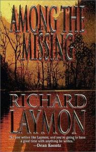 A shadow looms over the woods on the book's cover.