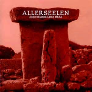 A phallic rock stands before a stone tablet on the album cover.