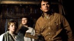 Bill Paxton readies an axe as two boys cower behind him in a still from the film.