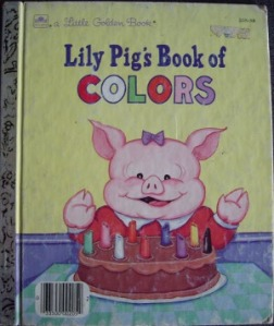 Lily Pig rejoices over her birthday cake on the cover.