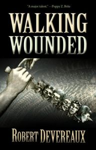 The new cover features a hand holding a shish full of heads.