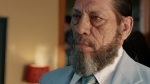 Danny Trejo is in a powder-blue suit in a still from the film.