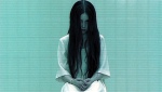 Sadako stares into the camera in a still from the film.