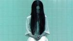 Sadako stares into the camera in a still from the film.
