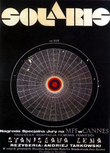 A large circle filled with geometric forms adorns the movie poster.