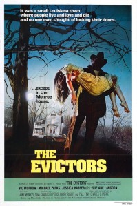 A dark figure carries a dead body away from a house on the movie poster.