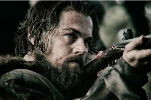 Glass (DiCaprio) takes a bead in a still from the film.